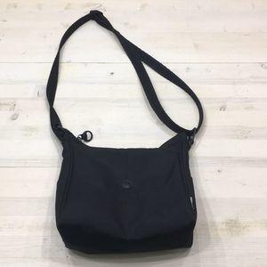 Pacsafe black crossbody purse